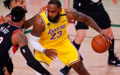 LeBron James (23) being contested by two Portland Trail Blazers in Game 1 of the 2020 NBA Playoffs.