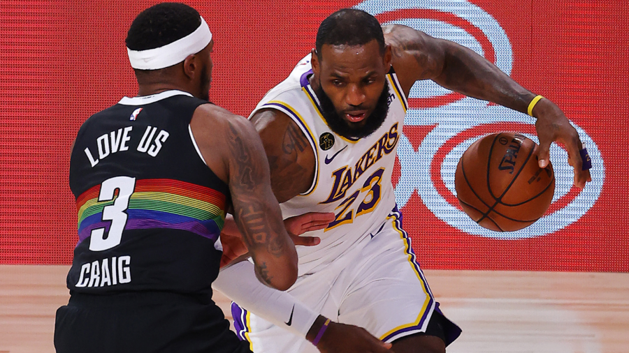 LeBron James (23) looks to drive past the feisty Torres Craig (3)