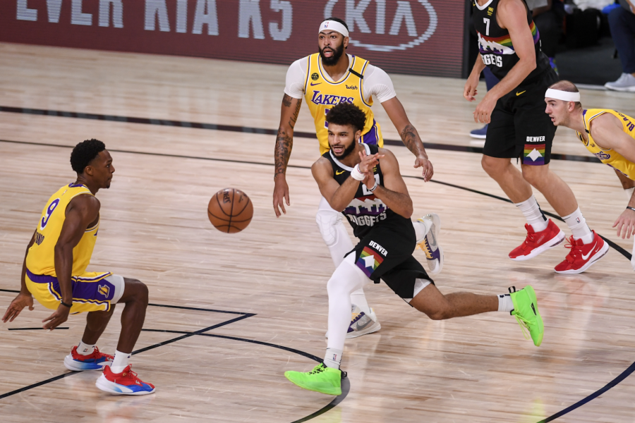 Jamal Murray (27) dishes out the aggressive pass while surrounded by Purple & Gold