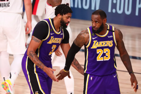 LeBron James (23) gives Anthony Davis (3) some props in Game 3 of the 2020 NBA Playoffs